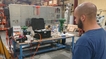 Photo by Bob Goodwin: training at BBP, mounting a digital D400 on a linear Fisher actuator.